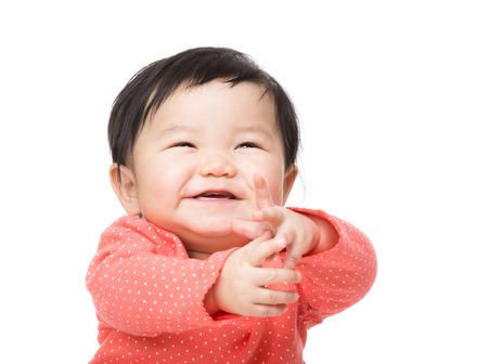 manos aplaudiendo: Bebé que siente emocionado Foto de archivo