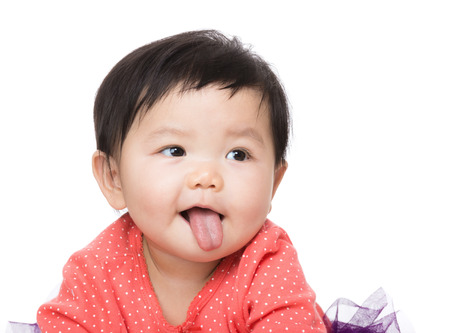 Baby with tongue sticking out photo