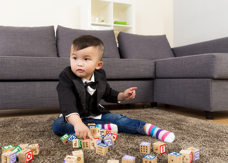Little boy play with toy block photo
