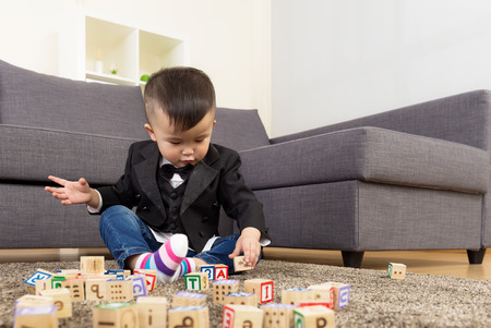 Asia baby boy play wooden toy block photo