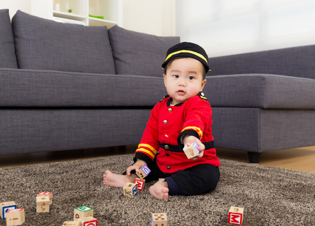 Little boy playing with toys block photo