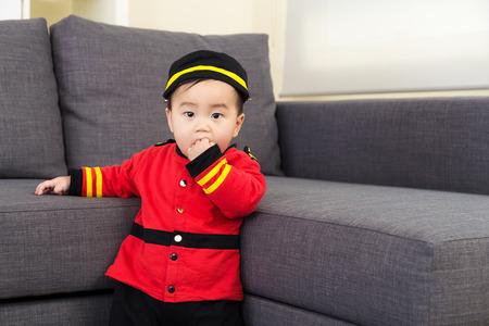 Little boy suck finger into mouth photo