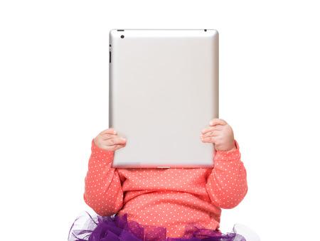 Baby additict to digital tablet Фото со стока - 26116672