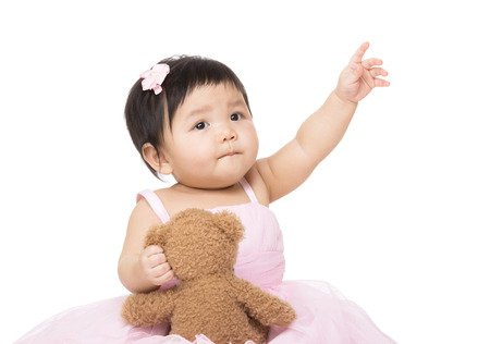 asian baby girl: Asian baby girl with doll and pointing up