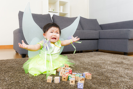 Asian baby girl crying with halloween party dressing photo