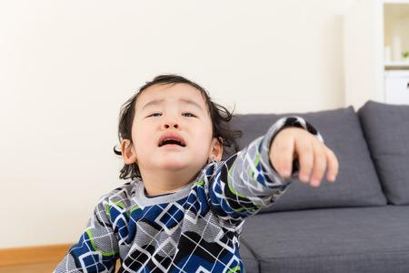 Asian baby boy feeling upset photo
