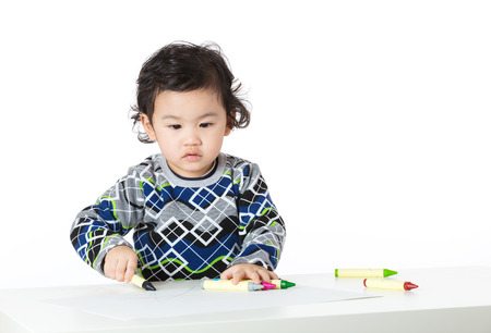 concentrate on: Asian baby boy concentrate on drawing Stock Photo