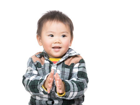 Asian baby boy clapping hand photo
