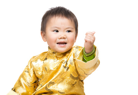 extol: Chinese baby boy with traditional costume and thumb up Stock Photo