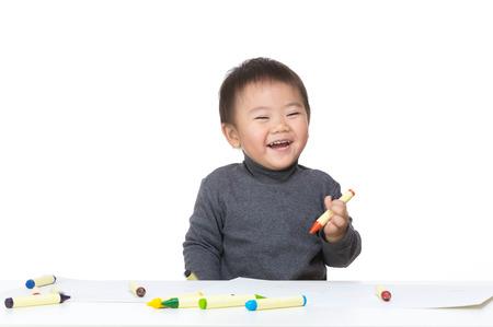 Asian baby boy enjoy drawing photo