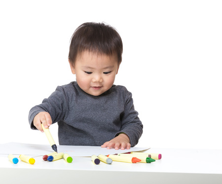 concentrate on: Asia baby boy concentrate on drawing