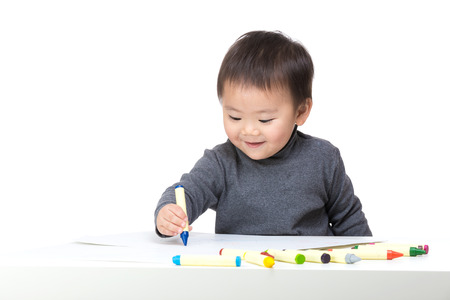 Asian bay boy concentrate on drawing photo