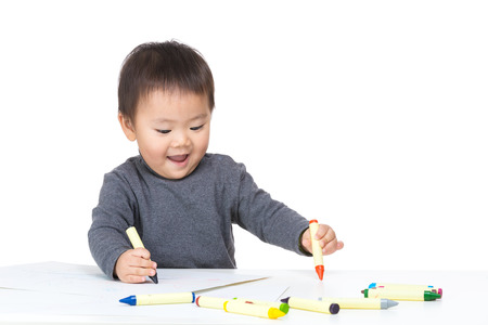 Baby boy drawing with crayon photo