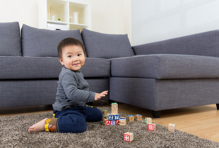 Baby boy play toy block photo