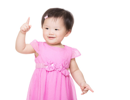 Little girl pointing up with finger photo