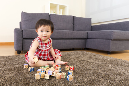 assiduous: Little girl play with toy block Stock Photo