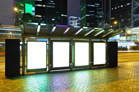 bus stop: Blank billboard in city at night Stock Photo