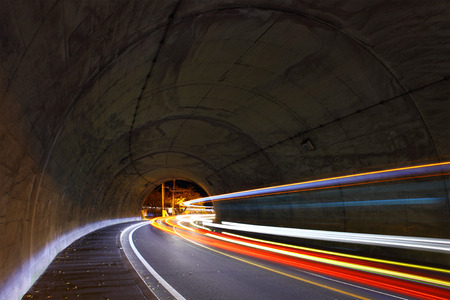 Traffic trail in tunnel photo