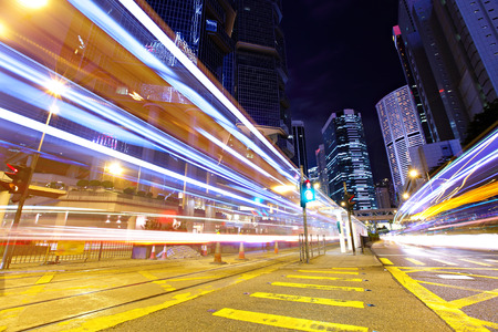 Fast moving car light in Hong Kong at night photo