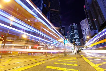Fast moving car light in Hong Kong at night photo