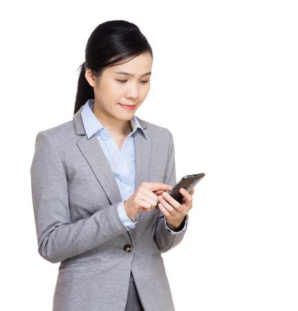 Asia businesswoman using mobile photo