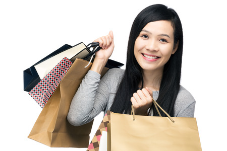 Asian woman with lots of shopping bag photo