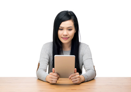 Asia woman using tablet photo