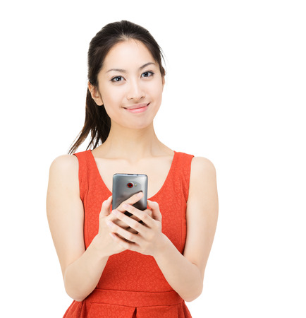 Asia woman holding mobile phone photo