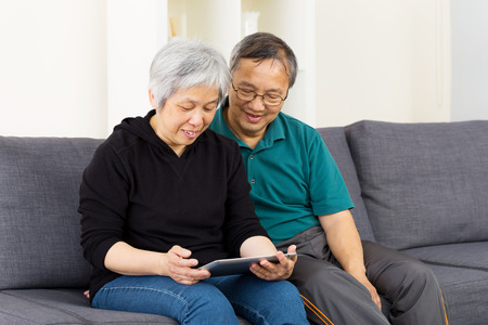 Asian couple using tablet together photo