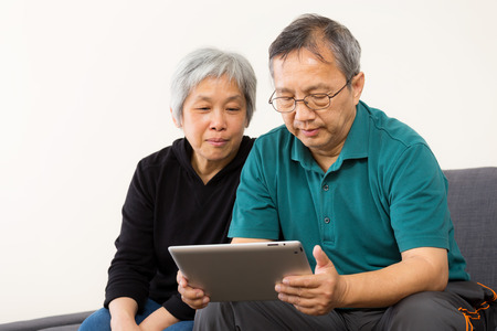 Asia couple using tablet at home photo