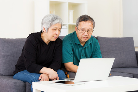 Asian old couple using laptop photo