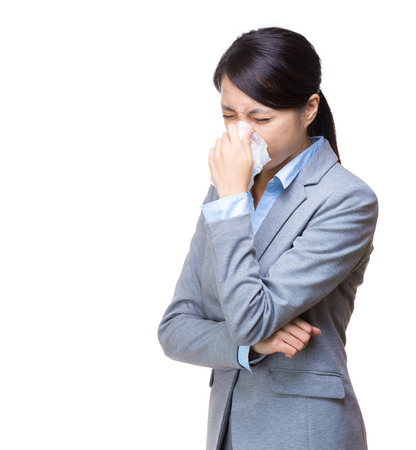 Asia businesswoman sneeze photo