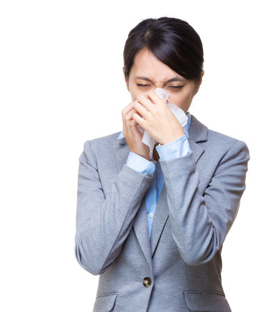 Asian businesswoman sneeze photo