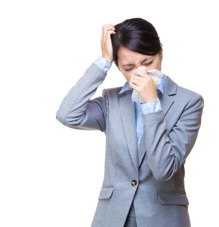 Asian businesswoman sneeze and headache photo