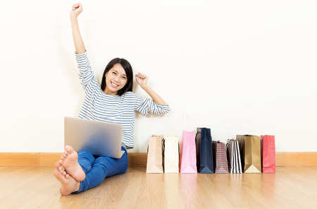 Asia womwn excited about shopping online