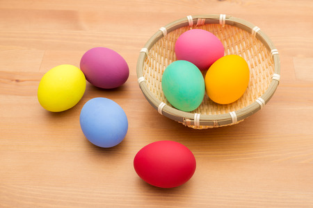 Colourful easter egg in basket photo