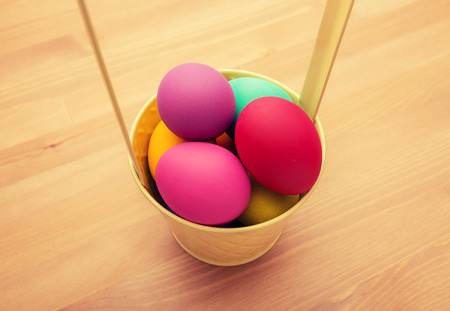 Colourful easter egg in bucket photo
