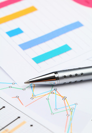 graphical: Graphical chart and pen Stock Photo