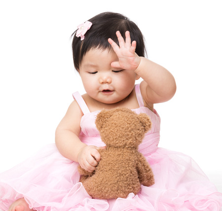 bear doll: Asian baby girl play with doll