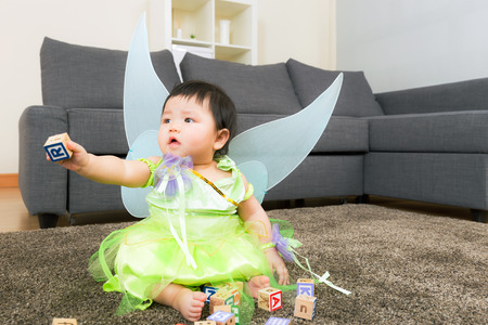 asian baby girl: Asian baby girl with halloween party dressing and play toy block Stock Photo