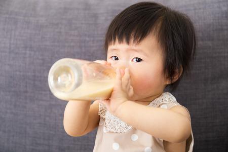 asian baby girl: Asian baby girl feed with milk bottle Stock Photo