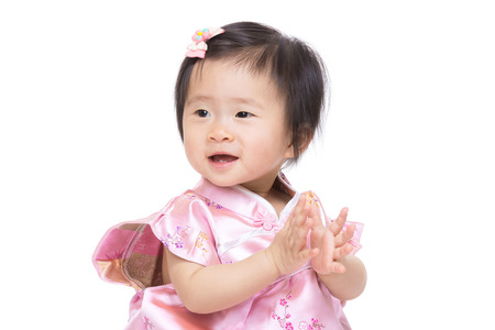 Chinese baby girl clapping hand photo