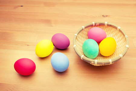 Colourful painted easter egg and basket photo