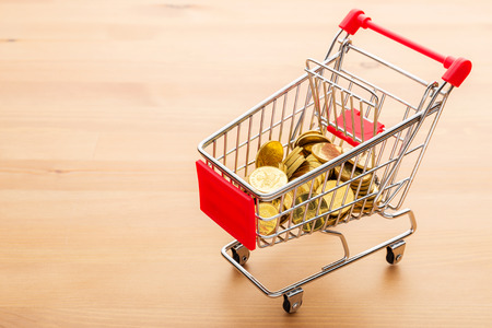 Golden coin in trolley Stock Photo - 26753482