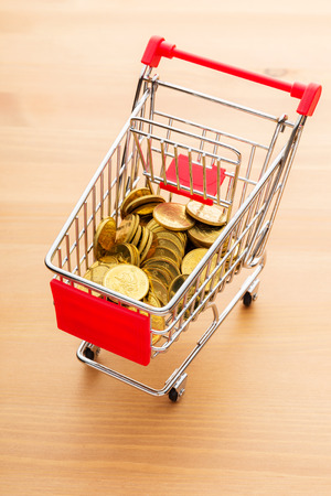 Golden coin in trolley photo