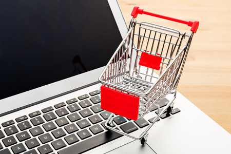 auctioning: Cart on a laptop Stock Photo