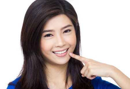 beautiful smile: Asia woman pointing to her mouth and teeth Stock Photo