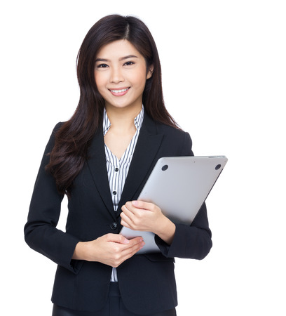 Asia businesswoman hold with laptop photo