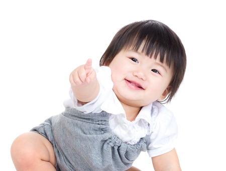 Asian baby girl finger pointing toward front photo