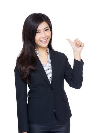 extol: Asia businesswoman thumb up gesture Stock Photo